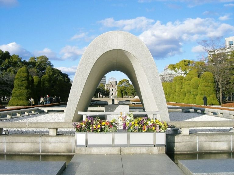 Hiroshima Peace Memorial Park monument with a-bomb dome in background