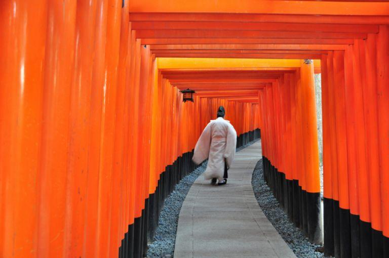 Fushimi Inari Shrine vermillion torii gates shinto priest